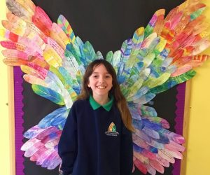 A pupil in front of angel wings